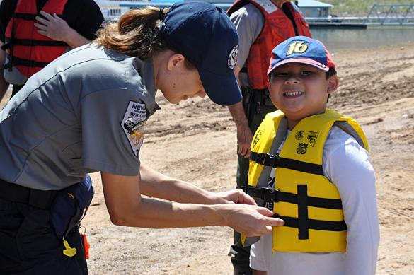 State agency staff helps with a lifejacket
