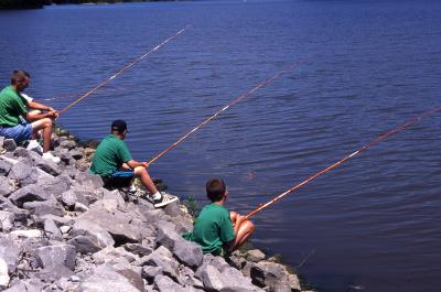 A trio of anglers on the riverbank