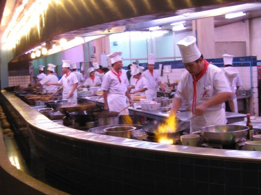 Kitchen crowded with cooks