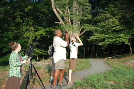 Dr. Drew Lanham birdwatching with others
