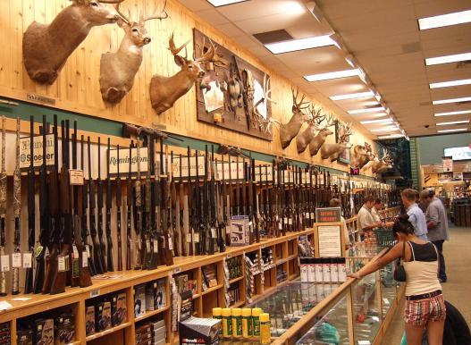 Gun store service desk and customers